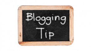 Small blackboard with a wooden frame with 'Blogging Tip' written in white chalk on it.